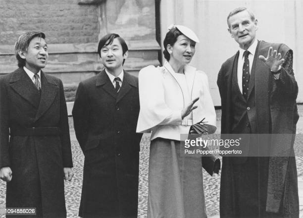 Crown Prince Akihito of Japan pictured on left with Princess Michiko and their son Prince Naruhito as they are given a tour of Merton College Oxford...