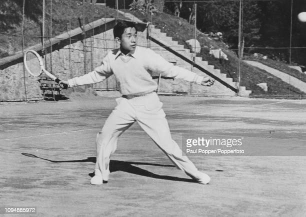Crown Prince Akihito of Japan pictured playing a game of tennis at the Suvretta House Hotel in St Moritz Switzerland on 11th September 1953
