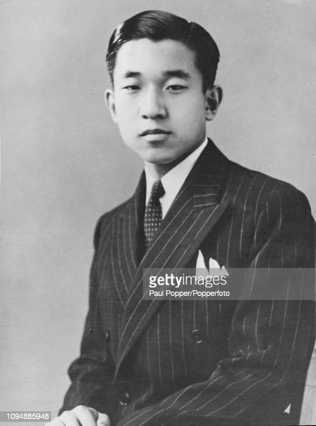 Crown Prince Akihito of Japan posed wearing a double breasted chalk stripe suit in Tokyo Japan circa 1951