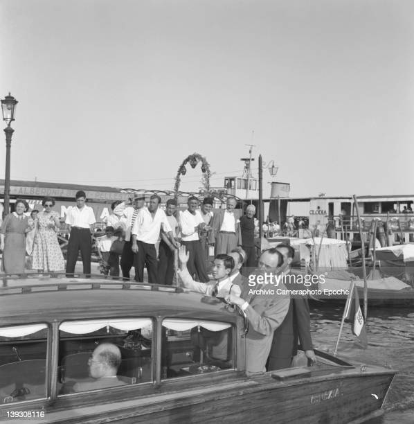Crown Prince Akihito of Japan taking a water taxi Venice 1953