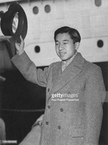 Crown Prince Akihito of Japan waves to spectators on the quayside as he steps off the Cunard liner RMS Queen Elizabeth at Southampton in England on...