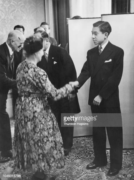 Crown Prince Akihito of Japan welcomes guests arriving at a reception London May 1953 The Crown Prince is in London to attend the coronation of Queen...