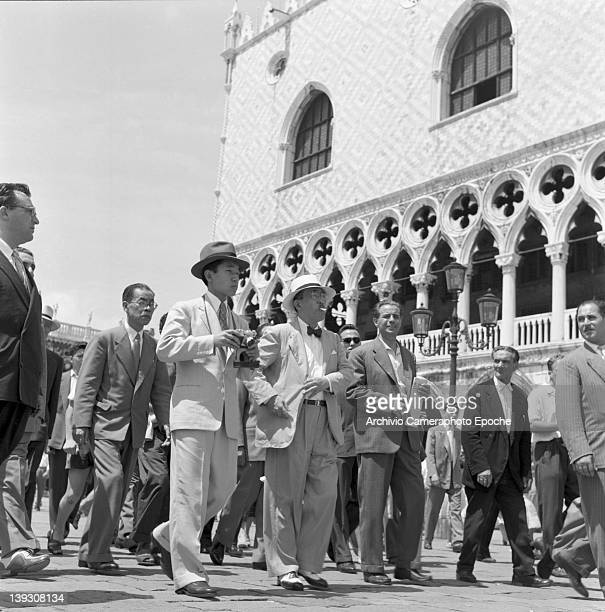 Crown Prince Akihito of Japan with diplomatic staff in St Mark's Square Venice 1953