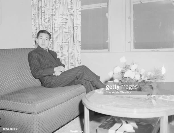 Crown Prince Akihito poses for photographs at Neptune Suite of the cruise ship President Wilson on the way to Hwaii from Yokohama on March 30 1953...