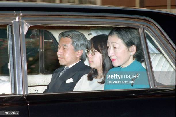 Crown Prince Akihito Princess Sayako and Crown Princess Michiko are seen on arrival at the Imperial Palace to see Emperor Hirohito on December 23...