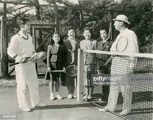 Crown Prince Akihito Princess Takako Empress Nagako Princess Atsuko Prince Masahito and Emperor Hirohito enjoy tennis at the Imperial Palace on...
