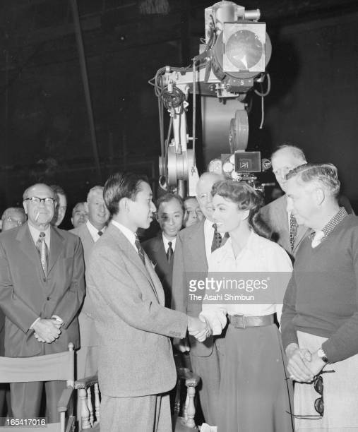 Crown Prince Akihito shakes hands with actress Ann Blyth who is on the filming of 'Rose Marie' at MGM studio on September 30 1953 in Hollywood...