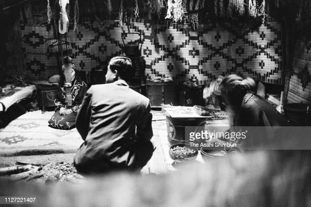 Crown Prince Akihito talks with Ainu elderly people on June 24 1958 in Asahikawa Hokkaido Japan
