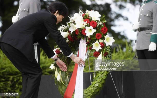 Crown Prince Akishino lays a wreath by a monument of an unknown Finnish soldier at Hietaniemi Cemetery in Helsinki Finland on July 3 2019 During...