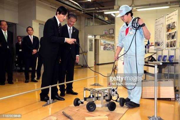 Crown Prince Akishino tries a robot operation at Denso Takatana Plant on May 28, 2019 in Anjo, Aichi, Japan.