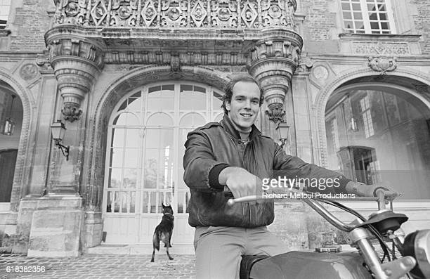 Crown Prince Albert of Monaco rides on his motorcycle at the royal Grimaldi family's French villa Two months earlier Princess Grace formerly Grace...