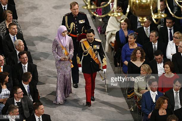 Crown Prince AlMuhtadee Billah and Princess Sarah of Brunei enter the church to attend the inauguration of HM King WillemAlexander of the Netherlands...