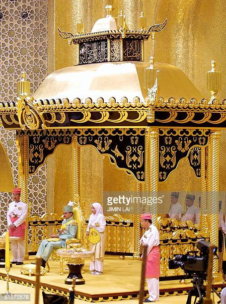 Crown Prince AlMuhtadee Billah Bolkiah sits on the royal dias in the Throne Chamber during the traditional henna ceremony at the Nurul Iman royal...