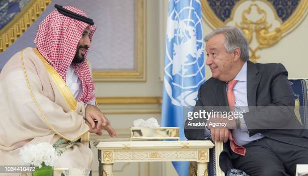 Crown Prince and Defense Minister of Saudi Arabia Mohammad bin Salman alSaud and United Nations Secretary General Antonio Guterres chat at a signing...