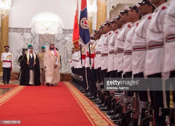Crown Prince and Defense Minister of Saudi Arabia Mohammad bin Salman alSaud is welcomed by King Hamad bin Isa bin Salman Al Khalifa of Bahrain with...