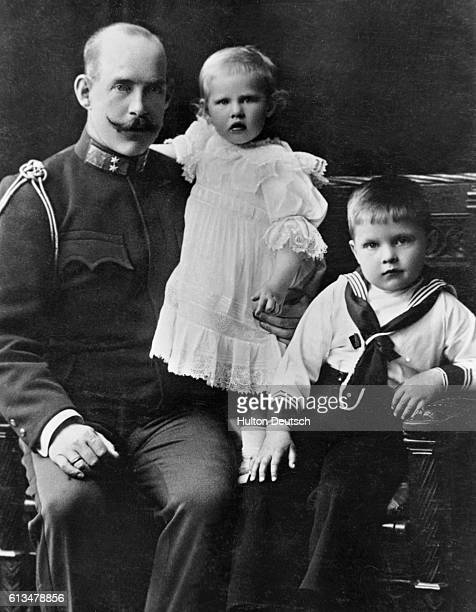 Crown Prince Constantine of Greece with young Prince Paul and Princess Irene. Constantine became king of Greece in 1913, until his deposition in...