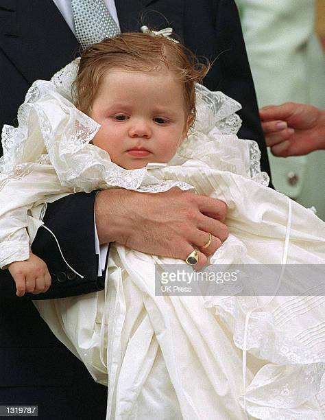 Crown Prince Crown Princess Pavlos of Greece pose for photographers holding their son Achileas Andraes while attending his christening June 7 2001 at...