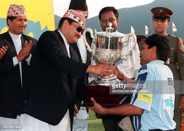 Crown Prince Dipendra of Nepal gives the winner's cup to Indian captain Kapil Dev in Kathmandu 09 May 1999 after the final of the Tempo World Legends...