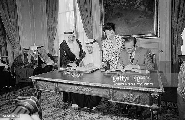 Crown Prince Fahd of Saudi Arabia and French Prime Minister Jacques Chirac sign an economic agreement in Paris Prince Fahd made an official visit to...
