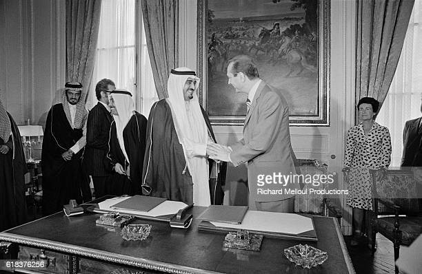 Crown Prince Fahd of Saudi Arabia and French Prime Minister Jacques Chirac shake hands after signing an economic agreement in Paris Prince Fahd made...