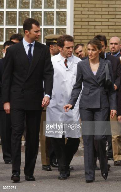Crown Prince Felipe of Spain and his fiancee Letizia Ortiz arrive at the Gregorio Maranon Hospital to visit victims of the bomb attack on a morning...