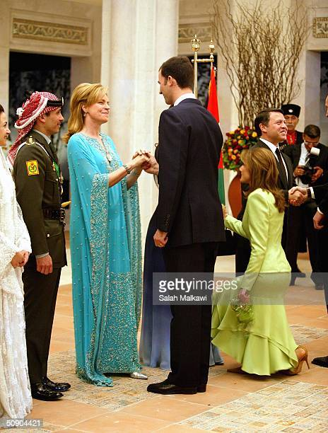 Crown Prince Felipe of Spain and his wife Princess Letizia congratulate Prince Hamzeh's mother Queen Noor as Crown Prince Hamzeh of Jordan and his...
