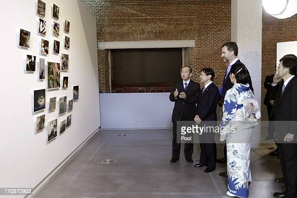 Crown Prince Felipe of Spain and Prince Naruhito of Japan visit the Tsunami Exhibition held at the Conde Duque's Cultural Center on June 11 2013 in...