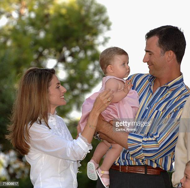 Crown Prince Felipe of Spain, his wife Princess Letizia and his daughter Princess Leonor attend a photocall during their summer holidays at Marivent...