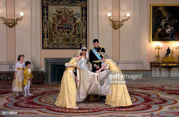 Crown Prince Felipe Of Spain Prince Of The Asturias With His Bride Crown Princess Letizia In The Royal Palace Helped With Her Dress By Her...