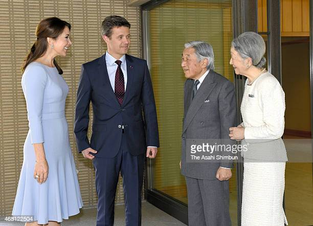 Crown Prince Frederik and Crown Princess Mary of Denmark are welcomed by Emperor Akihito and Empress Michiko prior to their meeting at the Imperial...