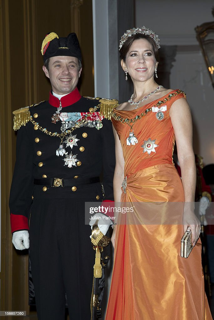 Crown Prince Frederik, and Crown Princess Mary of Denmark arrive at a New Year's Banquet hosted by Queen Margrethe of Denmark, at Christian VII's Palace, Amalienborg Palace on January 1, 2013 in Copenhagen, Denmark.