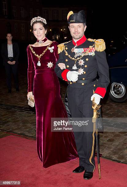 Crown Prince Frederik and Crown Princess Mary of Denmark arrive at the Traditional New Year's Banquet hosted by Queen Margrethe of Denmark at...