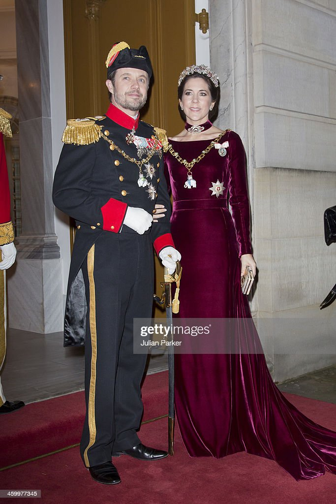 Crown Prince Frederik and Crown Princess Mary of Denmark arrive at the Traditional New Year's Banquet hosted by Queen Margrethe of Denmark, at, Amalienborg Palace, on January 1, 2014 in Copenhagen, Denmark.