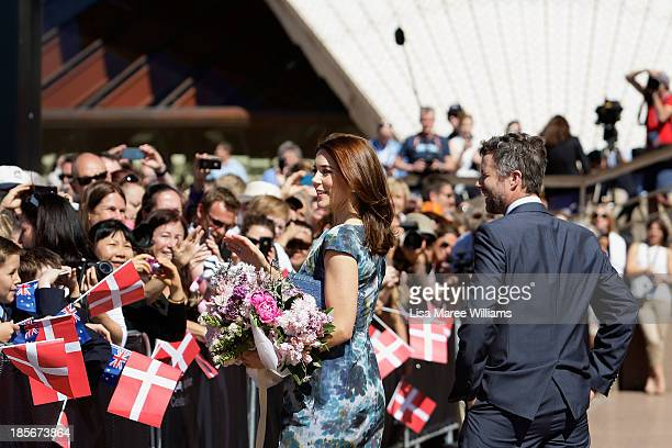 Crown Prince Frederik and Crown Princess Mary of Denmark greet members of the public on the Opera House forecourt on October 24 2013 in Sydney...