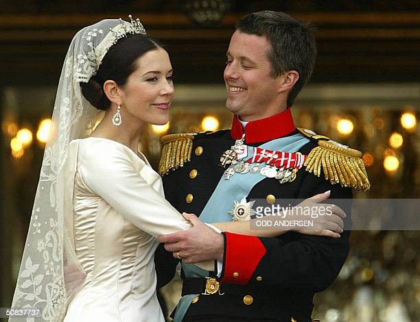 Crown prince Frederik and Crown princess Mary of Denmark hold each other while greeting wellwishers from the balcony at Amalienborg castle in...