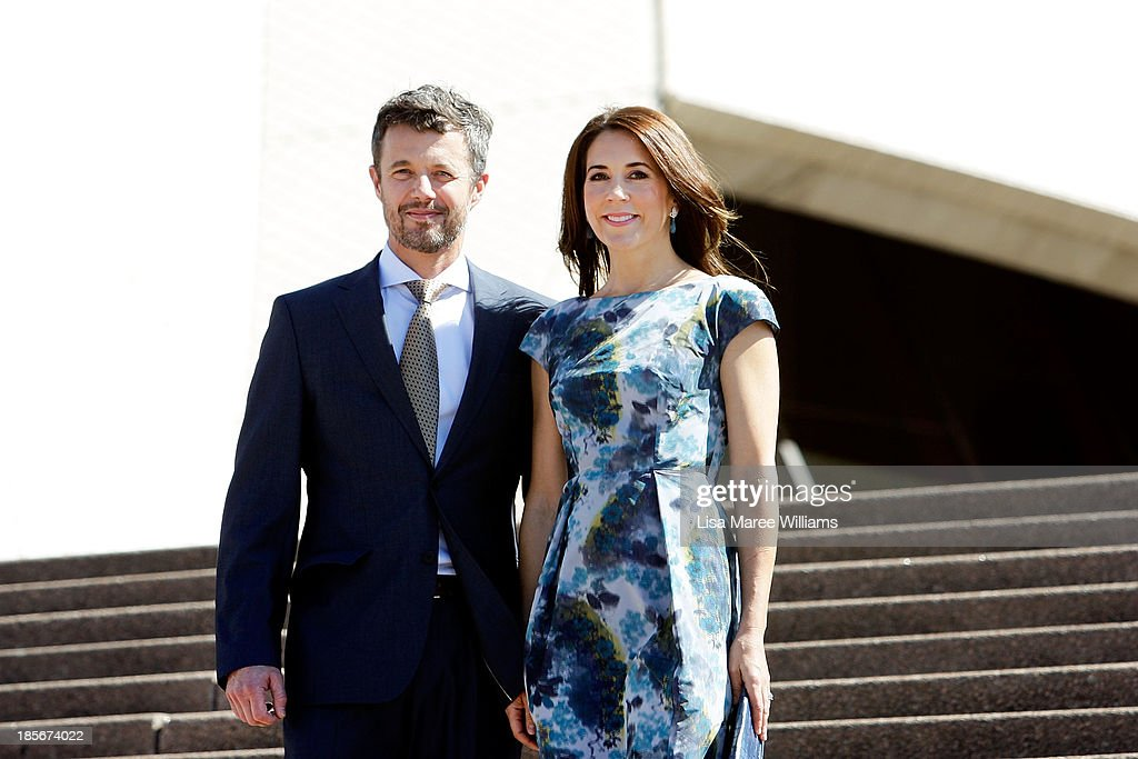 Crown Prince Frederik and Crown Princess Mary of Denmark pose on the steps of the Opera House forecourt on October 24, 2013 in Sydney, Australia. Prince Frederik and Princess Mary will visit Sydney for five days and will attend events to celebrate the 40th anniversary of the Sydney Opera House and the Danish architect who designed the landmark, Jorn Utzen.