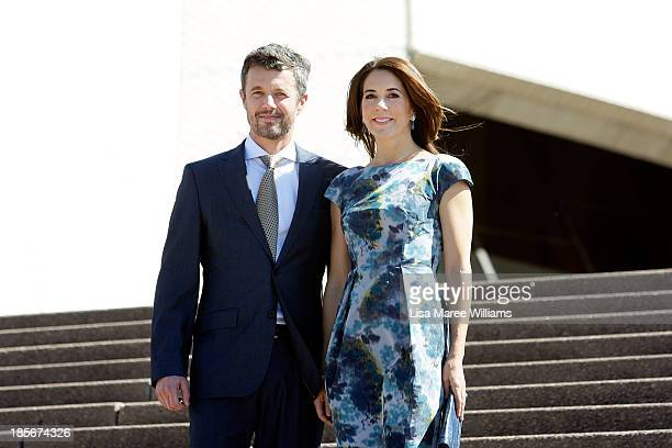 Crown Prince Frederik and Crown Princess Mary of Denmark pose on the steps of the Opera House forecourt on October 24 2013 in Sydney Australia Prince...