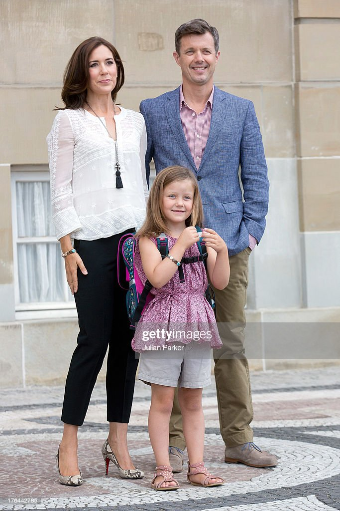 Crown Prince Frederik, and Crown Princess Mary of Denmark, with their daughter Princess Isabella depart Amalienborg Palace for Princess Isabella's first day at Tranegard School on August 13, 2013 in Copenhagen, Denmark.