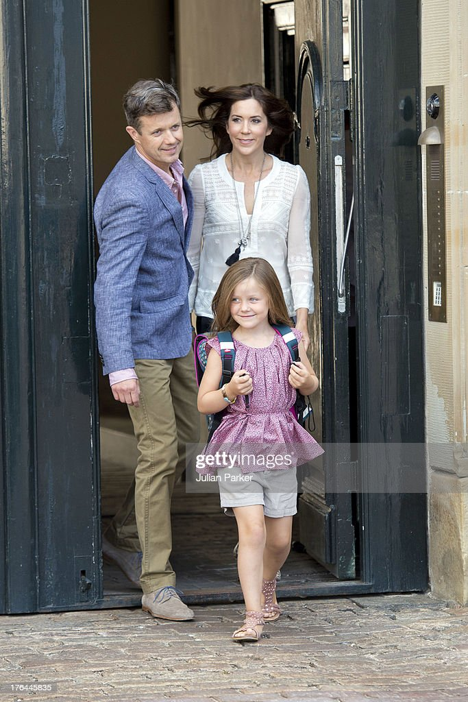 Crown Prince Frederik, and Crown Princess Mary of Denmark, with their Daughter Princess Isabella depart Amalienborg Palace for Princess Isabella's first day at Tranegard School, near Copenhagen. on August 13, 2013 in Copenhagen, Denmark.