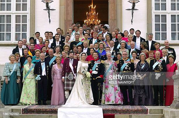 Crown Prince Frederik and Crown Princess Mary pose with family and guests on the stairs to Fredensborg Palace prior to the wedding banquet Friday May...