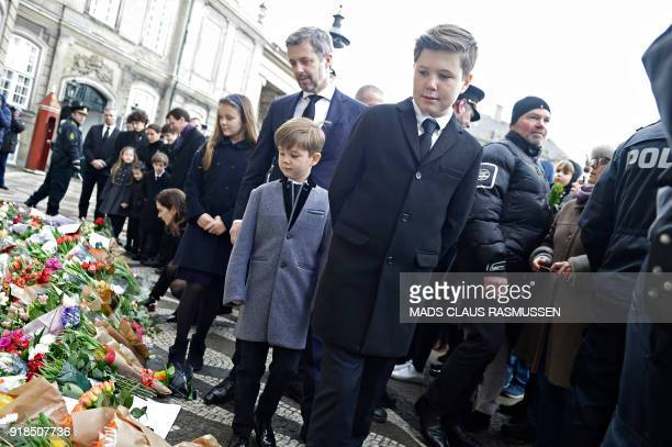 Crown Prince Frederik and Prince Christian look at flowers in front of the Amalienborg Palace in Copenhagen on February 15 2018 His Royal Highness...