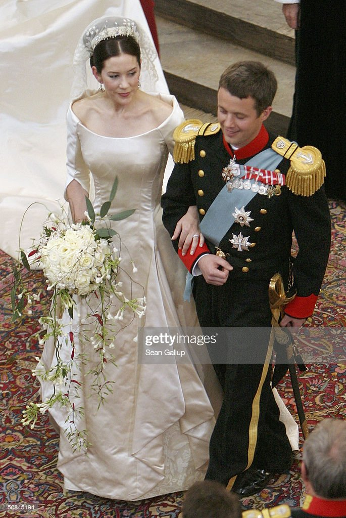 Crown Prince Frederik And Princess Mary Of Denmark Turn To Walk Up The Isle Copenhagen