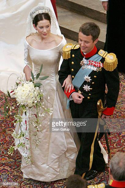 Crown Prince Frederik and Princess Mary of Denmark turn to walk up the isle of Copenhagen Cathedral after their wedding ceremony on May 14 2004 in...