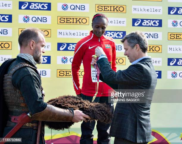Crown Prince Frederik gives the gold medal to Helen Oberi from Kenya on the podium after she won the women's senior race at the IAAF World Cross...