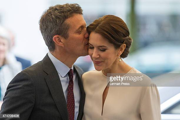 Crown Prince Frederik kisses his wife Crown Princess Mary Of Denmark as they arrive at a furniture shop during their visit to Germany on May 21, 2015...