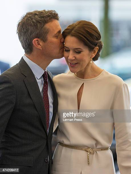 Crown Prince Frederik kisses his wife Crown Princess Mary Of Denmark as they arrive at a furniture shop during their visit to Germany on May 21 2015...