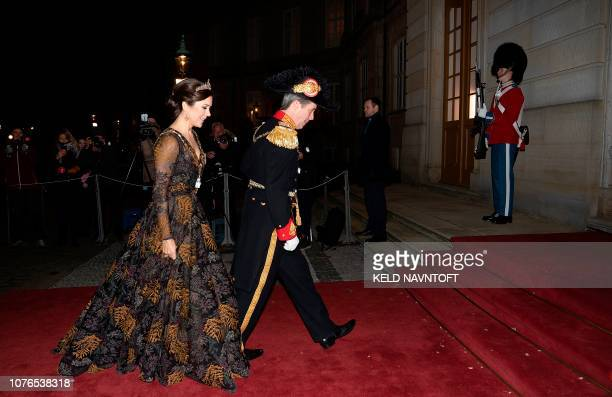 Crown Prince Frederik of Denmark and Crown Princess Mary of Denmark arrive at Her Majesty Queen Margrethe's traditional New Year's Banquet for...