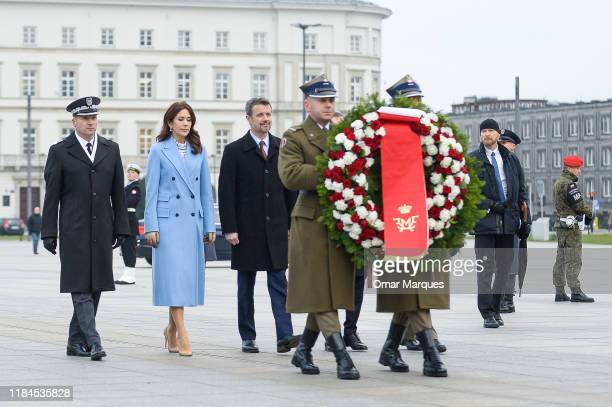 Crown Prince Frederik of Denmark and Crown Princess Mary of Denmark arrive at the Tomb of Unknown Soldiers on November 25 2019 in Warsaw Poland The...