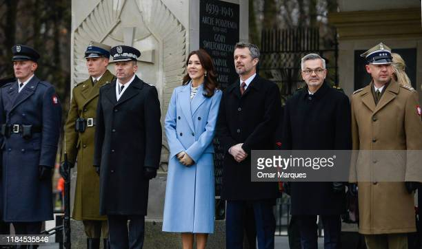 Crown Prince Frederik of Denmark and Crown Princess Mary of Denmark pay their respects at the Tomb of Unknown Soldiers on November 25 2019 in Warsaw...
