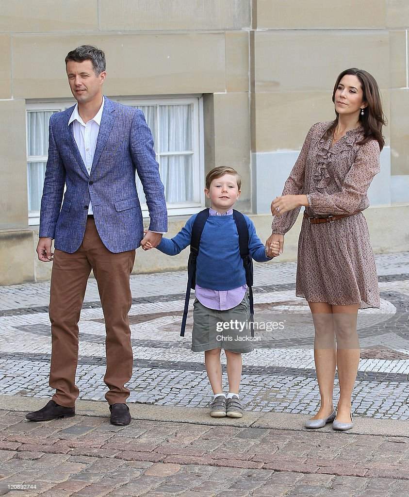 Crown Prince Frederik of Denmark and Crown Princess Mary of Denmark pose for photographs with their son Prince Christian of Denmark on his first day of School at Amalienborg Royal Palace on August 12, 2011 in Copenhagen, Denmark. Prince Christian will attend his first day at Tranegard School today.